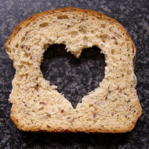 Slice of bread with heart cut-out in the middle